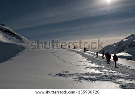 Antarctic iceberg with snow under the sunshine. - stock photo