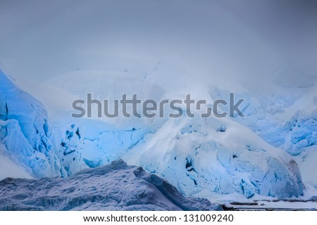 Antarctic icebergs with different shade of cold blue - stock photo