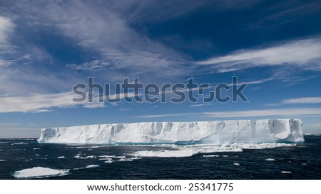 Antarctic tabular iceberg with blue sky