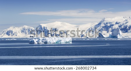 Antarctic. Travel on the scientific vessel among ices. Studying of a phenomenon of global warming. Ices and icebergs of unusual forms and colors. - stock photo