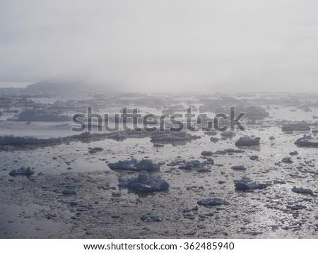 Antarctica foggy iceberg landscape ocean - stock photo