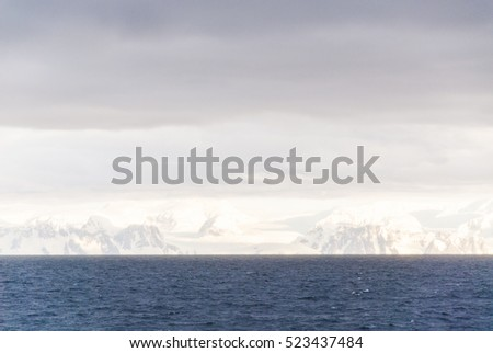 Antarctica in a cloudy day- Antarctic Peninsula - Palmer Archipelago - Neumayer Channel - Global warming - Fairytale landscape