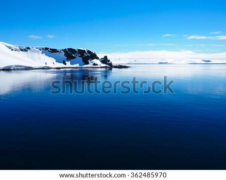 Antarctica mountain iceberg landscape ocean mirror reflection - stock photo