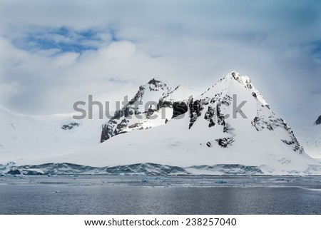 Antarctica mountains covered in fresh snow - stock photo