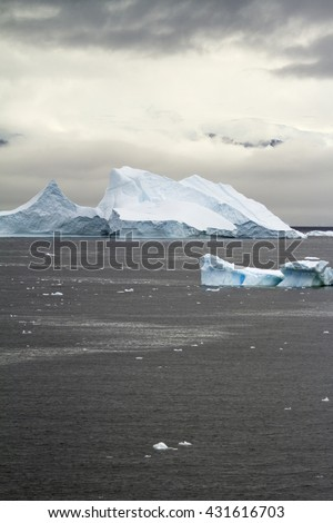 Antarctica - Non-Tabular Iceberg Floating In The Southern Ocean - Dry-dock Iceberg - Dramatic Landscape - Horizon Over Water - Travel Destination