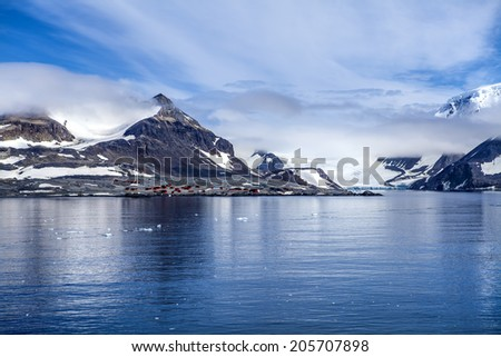Antarctica Outstanding Natural Beauty, Hope Bay, Trinity Peninsula with the scientific basis Esperanza Argentina in the background. Photo; december 27 2011 - stock photo