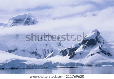 Antarctica Snow covered mountains and icebergs