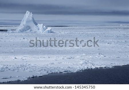 Antarctica Weddell Sea iceberg in ice field - stock photo