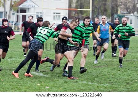 ANTARES - EGER, UKRAINE, KIEV- NOVEMBER 4 : Rugby players in action at a Ukrainian National Championship Final rugby match, Antares(in green) vs. Eger(in black), November 4, 2012 in Kiev, Ukraine. - stock photo