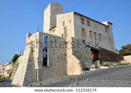 ANTBES,FRANCE - SEPTEMBER 6: Grimaldi Castle facade shown on September 6, 2012 in Antibes, France.Grimaldi Castle shelter the Picasso Museum, where are exposed paintings and ceramics of Pablo Picasso. - stock photo