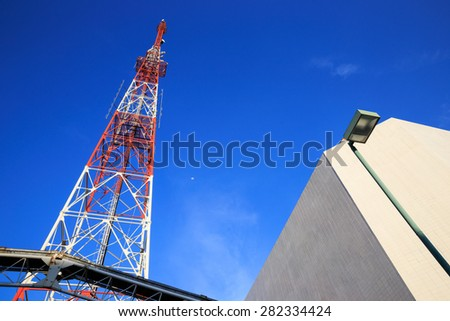 Antenna broadcast TV signal on sky and moon background - stock photo
