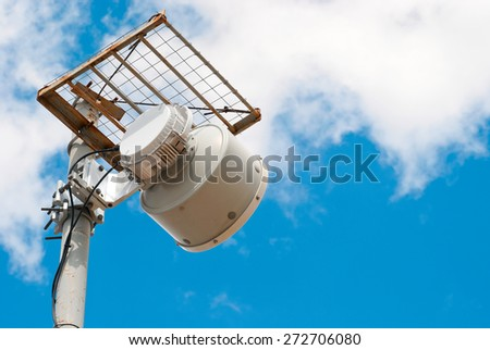 Antenna cellular base station against the blue sky - stock photo