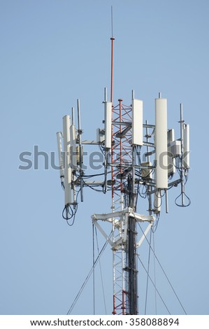 Antenna cellular signal mobile phone tower for telecommunication in blue sky.