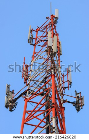 Antenna mast with transmitters isolated on blue background - stock photo