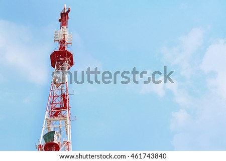 Antenna of communication building on blue sky background
