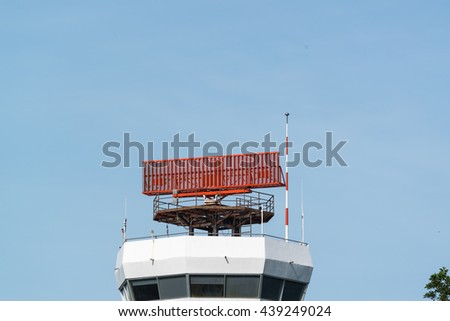 Antenna of secondary surveillance radar which is rotating to track the position of the aircraft with blue sky - stock photo