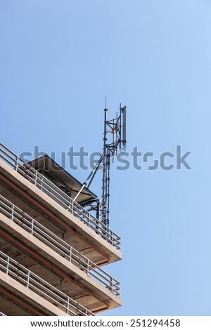 antenna on blue sunny sky - stock photo
