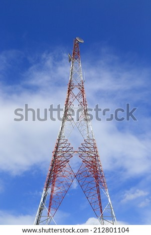 Antenna on the blue sky background - stock photo