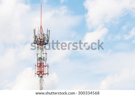 Antenna repeater tower on blue sky and white cloud, telecommunication concept