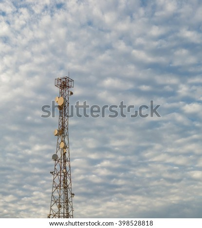 Antenna tower and blue sky with white cloud - stock photo