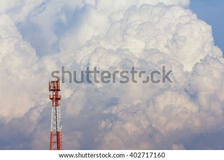 Antenna tower on big cloud background - stock photo