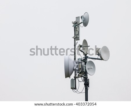 Antenna tower with some communication dishes. - stock photo