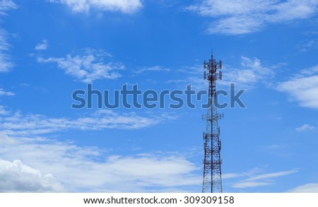 Antenna transmission tower, painted white and red in a day of clear blue sky. - stock photo