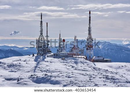 Antennas station at peak of mountain  - stock photo