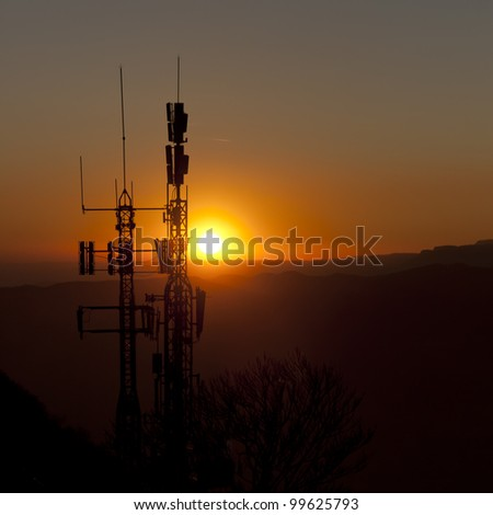 antennas to the light at sunset