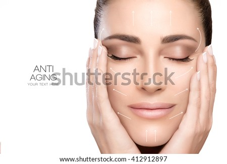 Anti aging treatment and plastic surgery concept. Beautiful young woman with hands on cheeks and eyes closed with a serene expression and white arrows over face. Isolated on white with copy space