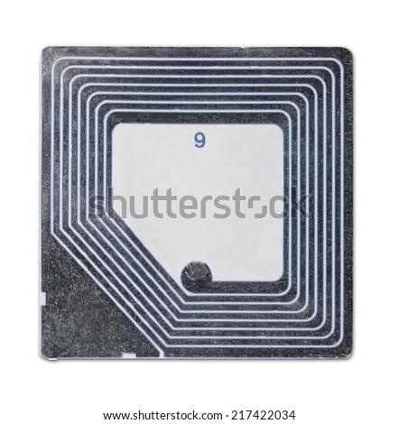 Anti shoplifting RFID tag isolated on white - stock photo
