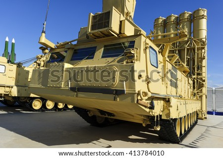 Antiaircraft missile complex, ballistic launcher with big four missiles ready to attack on military powerful all-terrain transportation with blue sky on background, modern army industry  - stock photo