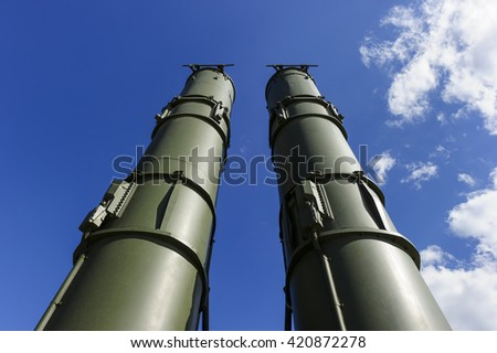 Antiaircraft missile complex, military ballistic launcher with two big missiles ready to attack with blue sky and white clouds on background, modern army industry  - stock photo