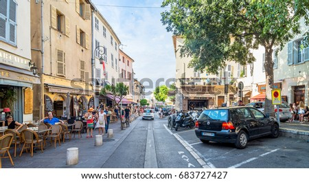 Antibes, France - July 01, 2016: day view of typical street in Antibes, France. Antibes is a popular seaside town in the heart of the Cote d'Azur.