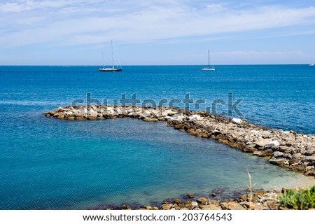 ANTIBES, FRANCE - JUN 25, 2014: Mediterranean Sea from the Old Town of Antibes, Cote d'Azur, France. Antibes was founded as a 5th-century BC Greek colony and was called Antipolis
