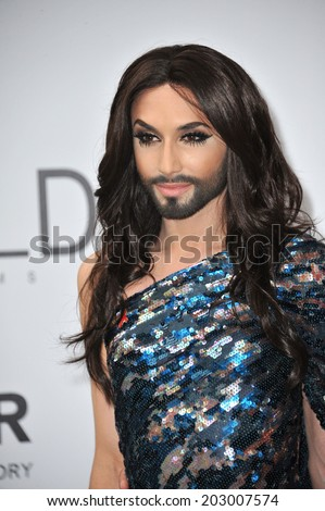 ANTIBES, FRANCE - MAY 22, 2014: Eurovision Song Contest winner Conchita Wurst  at the 21st annual amfAR Cinema Against AIDS Gala at the Hotel du Cap d'Antibes.  - stock photo