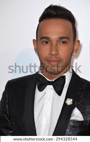 ANTIBES, FRANCE - MAY 21, 2015: F1 driver Lewis Hamilton at the 2015 amfAR Cinema Against AIDS gala at the Hotel du Cap d'Antibes, as part of the 68th Festival de Cannes. - stock photo