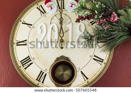 Anticipation of 2018 New Year celebration. Clock shows midnight.