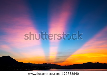Anticrepuscular arch in sunset - stock photo