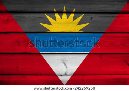 Antigua and Barbuda Flag on wood background - stock photo