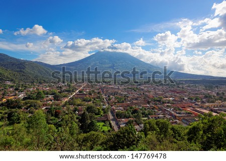 Antigua as viewed from Cerro de la Cruz, with Volcano De Agua in the background.  - stock photo