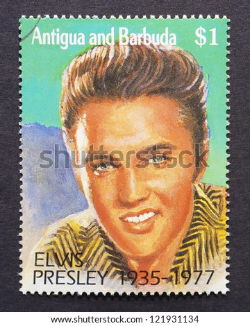 ANTIGUA & BARBUDA - CIRCA 1992: a postage stamp printed in Antigua and Barbuda showing an image of Elvis Presley, circa 1992. - stock photo