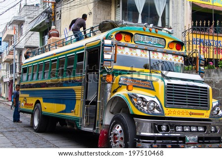 "ANTIGUA, GUATEMALA - APRIL 23: : A typical Guatemalan transport ""Chicken Bus"" in Antigua, Guatemala on April 23, 2014."
