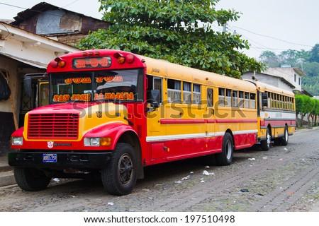 "ANTIGUA, GUATEMALA - APRIL 23: : A typical Guatemalan transport ""Chicken Bus"" in Antigua, Guatemala on April 23, 2014.  - stock photo"