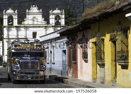 """ANTIGUA, GUATEMALA - DECEMBER 4: A typical """"Chicken Bus"""" travellng between Antigua and Guatemala City. This is one of the busiest routes in Guatemala. Antigua, Guatemala - December 4, 2013 - stock photo"""