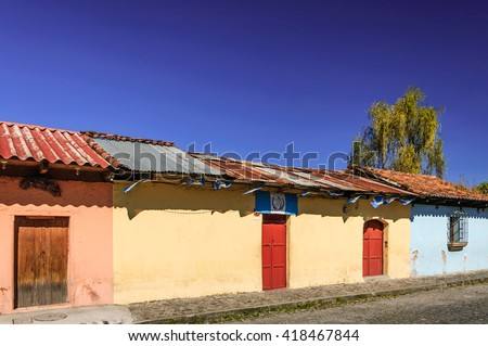 Antigua, Guatemala - October 5, 2014: Old colorful, painted houses adorned with Guatemalan flags in colonial city & UNESCO World Heritage Site of Antigua.