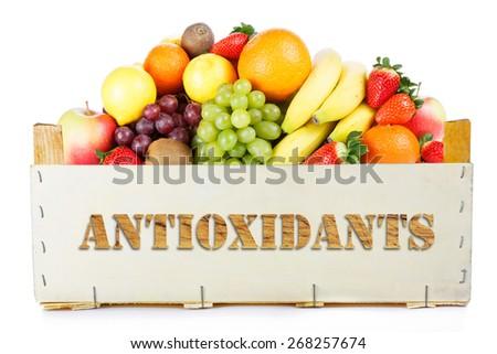 Antioxidants. Fruits in wooden box  - stock photo