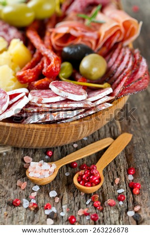 Antipasti and catering platter with different meat and cheese products - stock photo