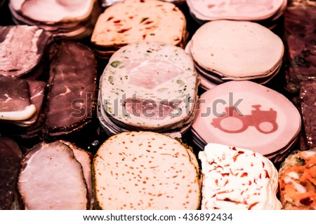 Antipasti composition of italian cured meat types. Salami, ham and Prosciutto di Parma slices, closeup and top view. Food background