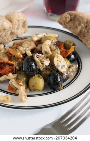 Antipasti made with olives sun dried tomato and shitake mushrooms - stock photo